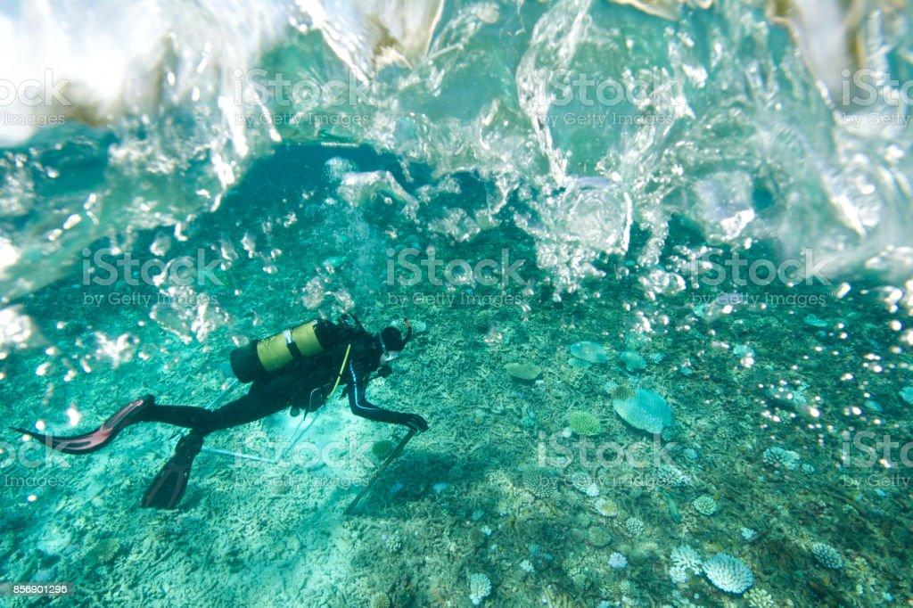 marine biologist under rough seas stock photo