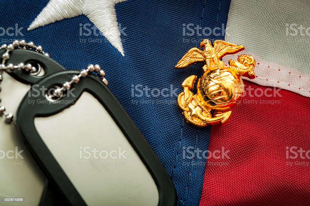 US Marine Corps emblem, dog tags and the American flag stock photo