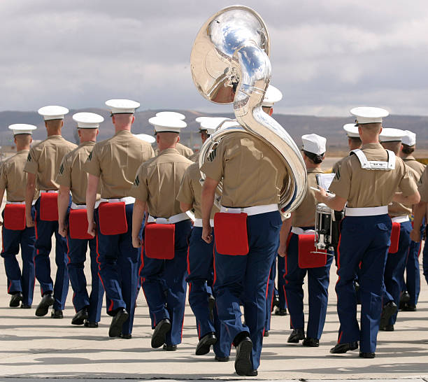 U.S. Marine Corps music band USMC band marching while playing in military ceremony. military parade stock pictures, royalty-free photos & images
