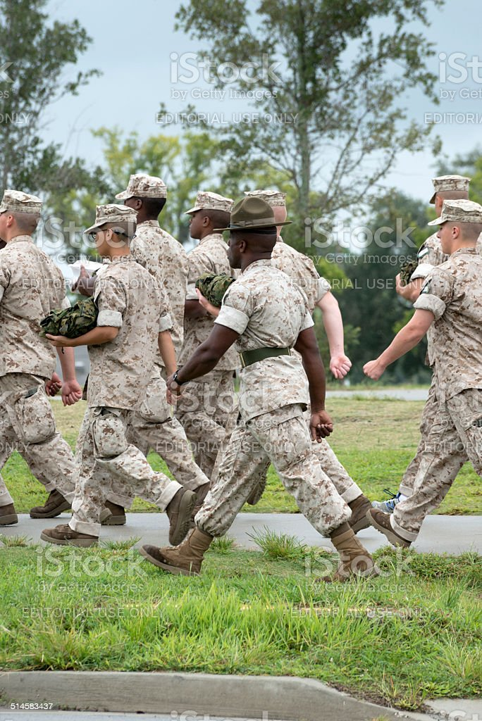 US Marine Corps recruits and drill instructor stock photo