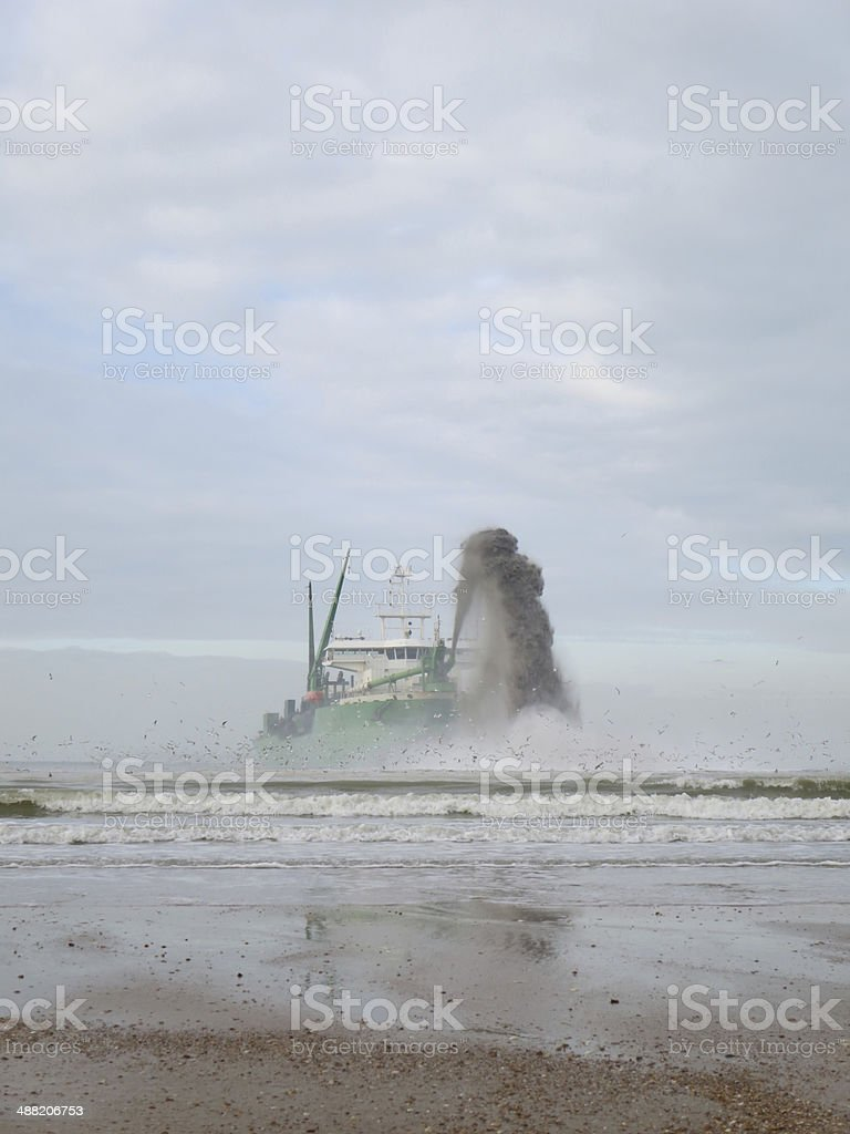 Marine Dredger Barge Squirting Sand stock photo