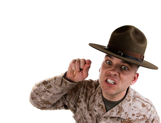 Marine drill instructor pointing forward wearing a brown hat Marine Drill Instructor getting in your face on white background. sergeant stock pictures, royalty-free photos & images