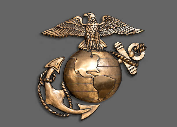 Marine Eagle ,Globe and Anchor. Marine eagle,globe and anchor brass emblem. insignia stock pictures, royalty-free photos & images