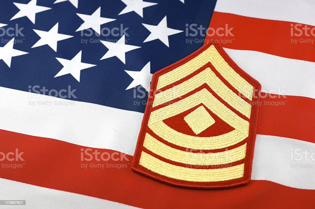 Marine First Sergeant Rank Insignia and Flag Background royalty-free stock photo
