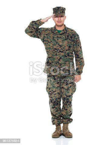 istock US Marine in uniform saluting 951325654