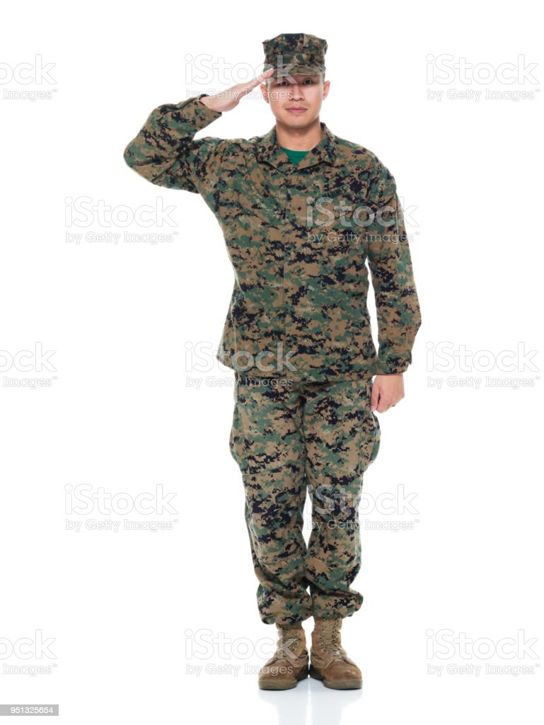 US Marine in uniform saluting stock photo