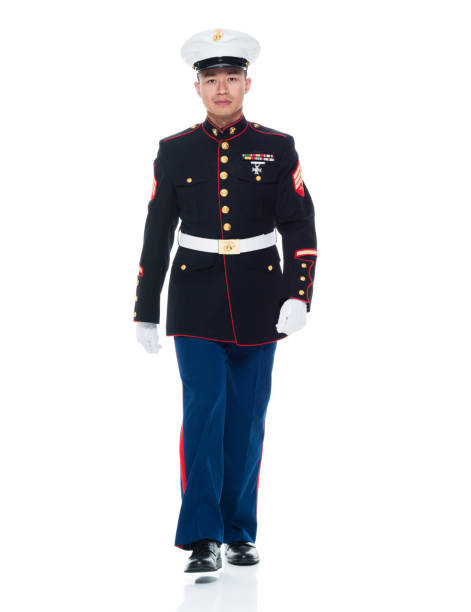 us marine in uniform walking - marines stock photos and pictures