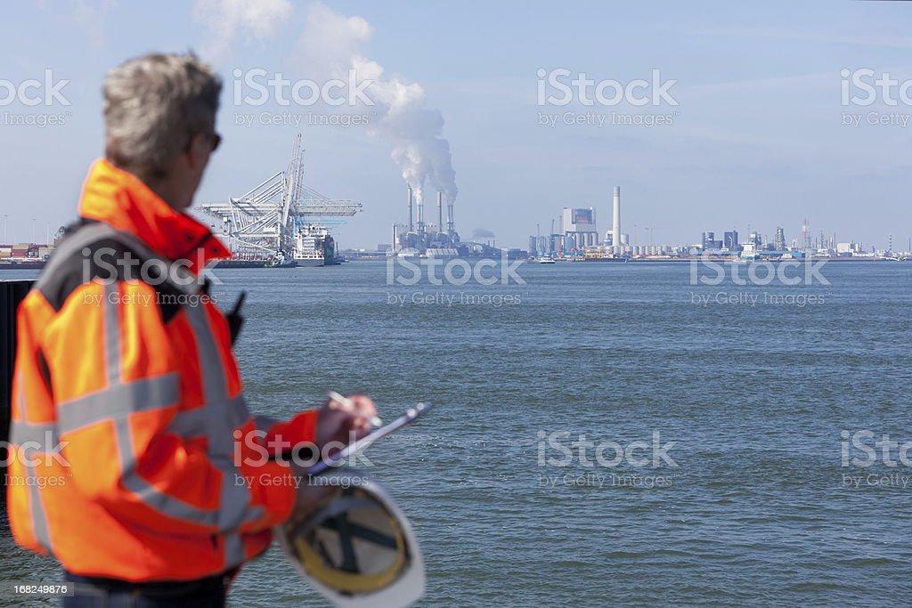 Marine inspector walking on a wall stock photo