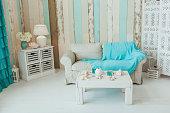 Marine Interior. White sofa and table, seashells, turquoise decor