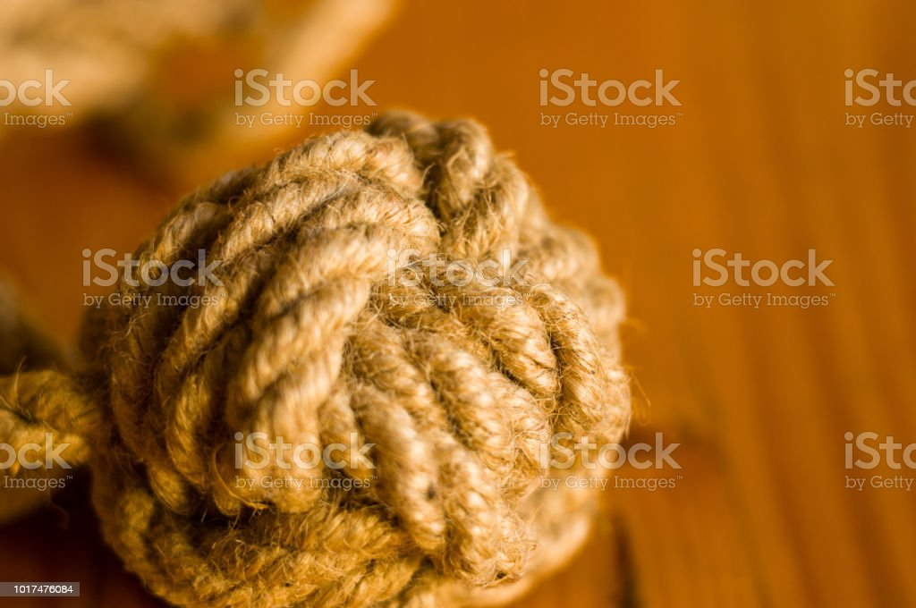 marine knot of thick brown rope stock photo