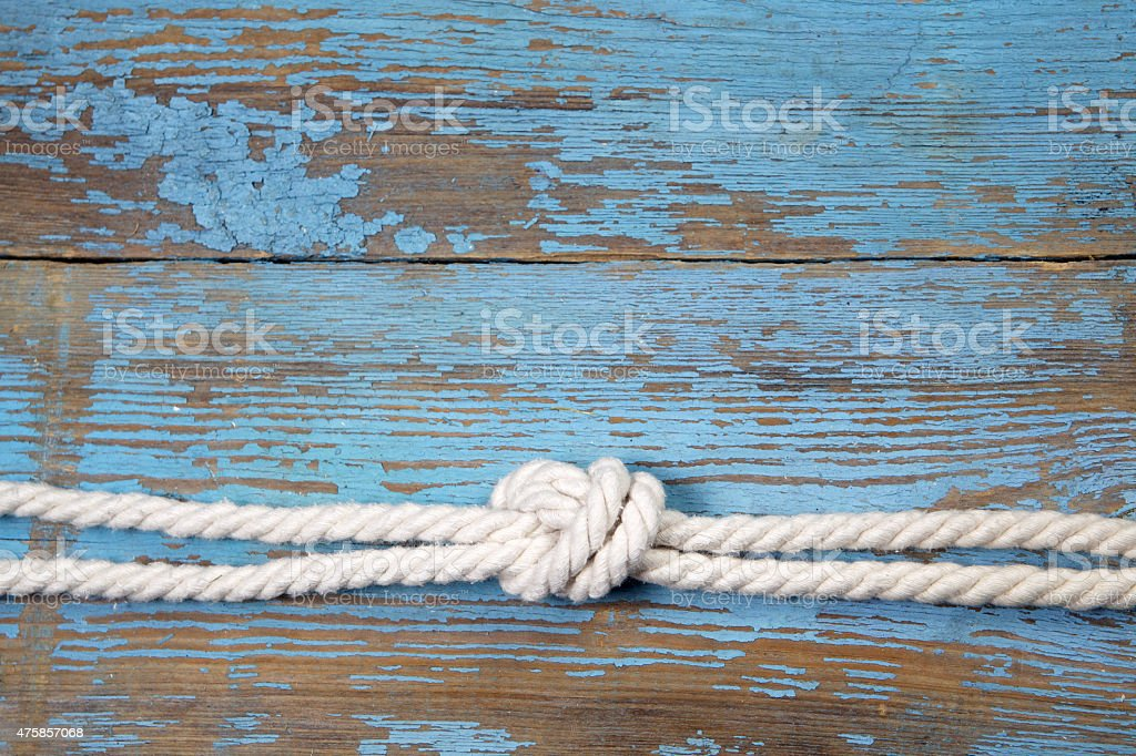 Marine knot on wooden background stock photo