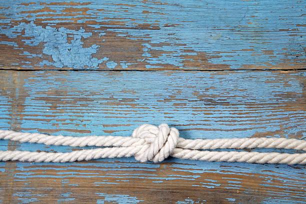 Marine knot on wooden background stock photo