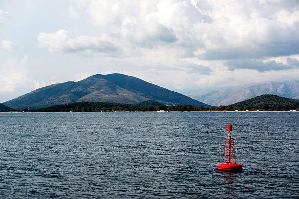 Marine navigation aids: Buoy and lighthouse - foto stock