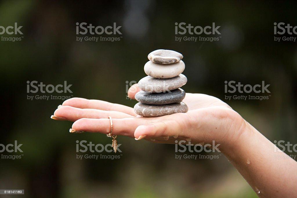 marine origin pebbles woman 's hand stock photo