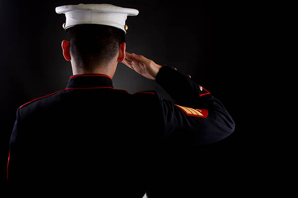 marine saluting in dress blues - saluting stock photos and pictures