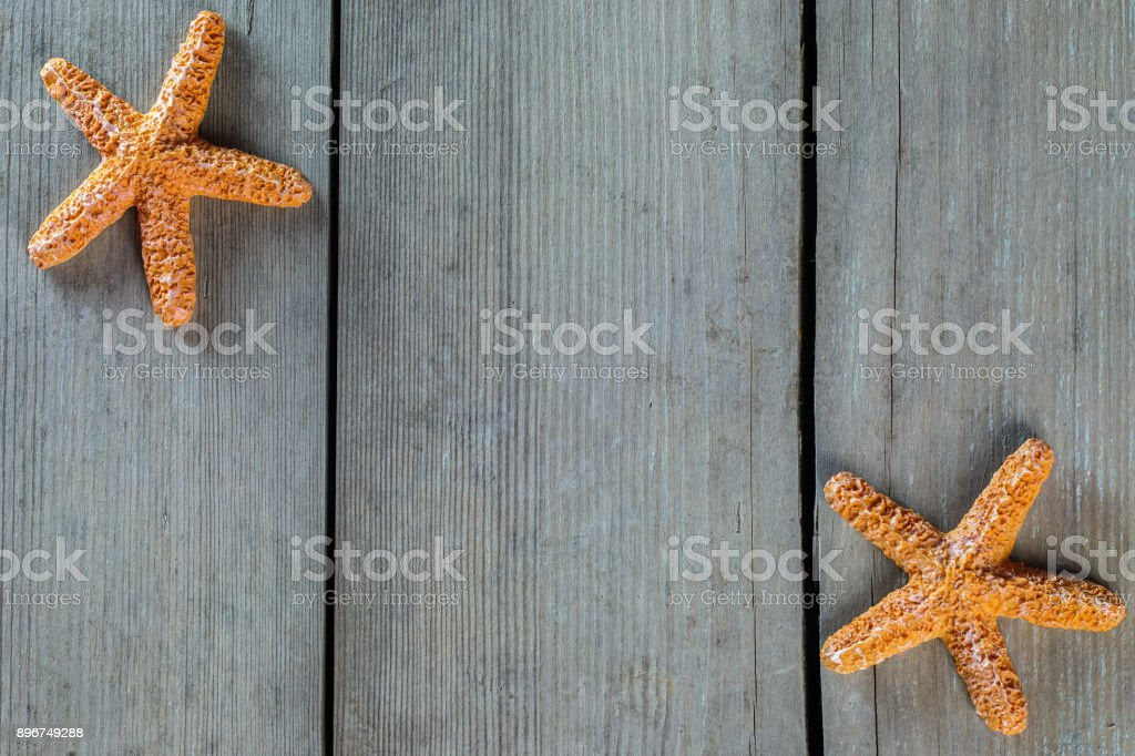 Marine theme. Wooden background. Sea stars. Space for text. stock photo