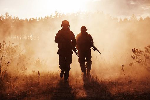 istock US Marines in action. Desert sandstorm 947295886