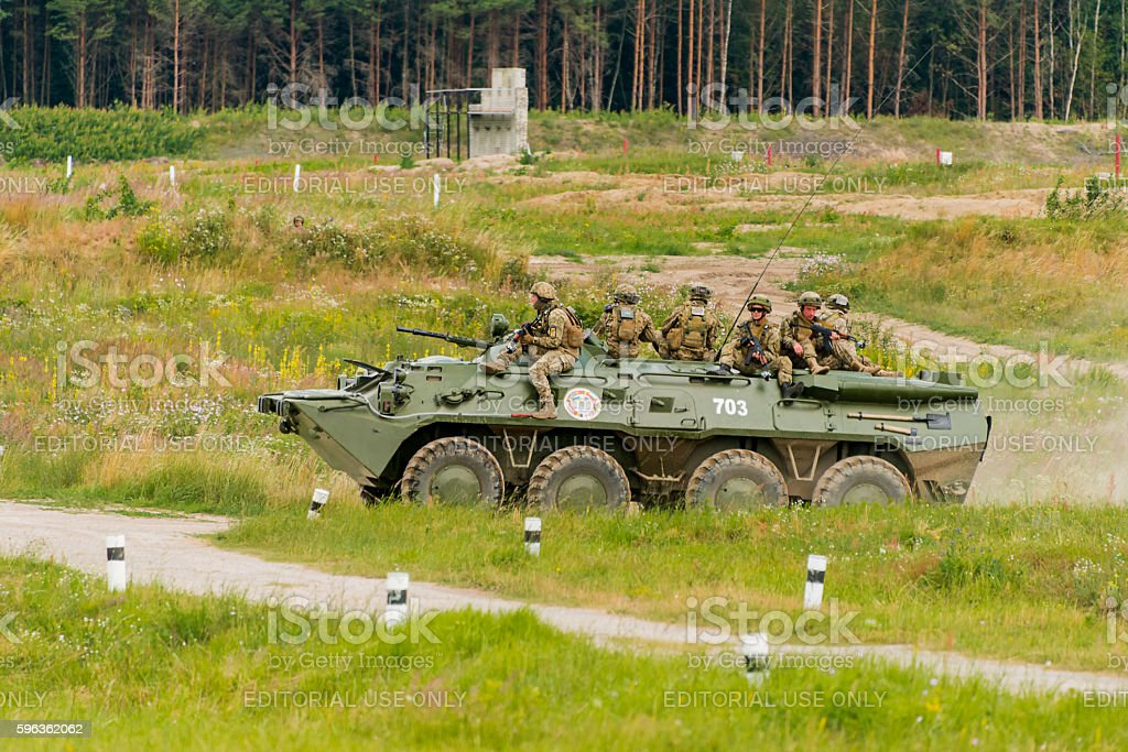 Marines move on an armored personnel carrier royalty-free stock photo