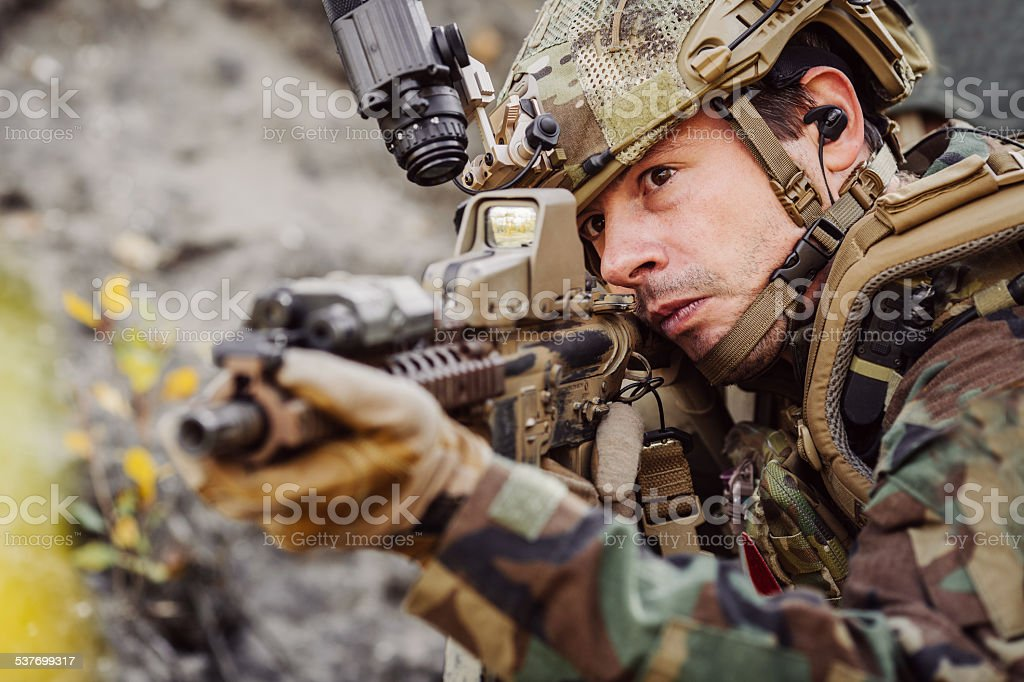 marines with a rifle aiming at a target stock photo