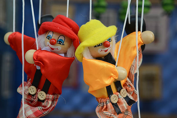 Marionette - puppet Marionette - puppet: Dolls on rope swing ventriloquist's dummy stock pictures, royalty-free photos & images