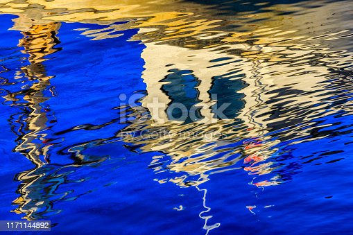 Docked fishing boat reflection in Malpeque Harbor on Prince Edward Island Canada