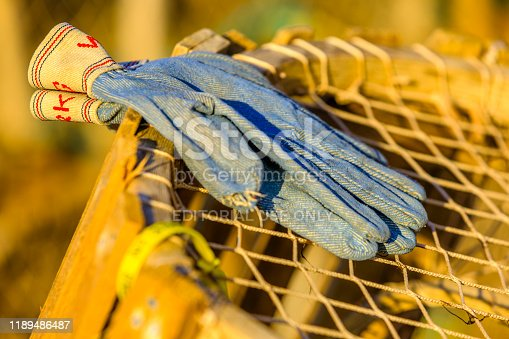 The Canadian maritime province of Prince Edward Island on September 04, 2011: Stacked lobster pots with set aside working gloves in the town of North Rustico on Prince Edward Island Canada
