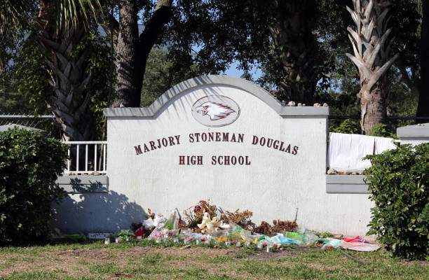 Marjory Stoneman Douglas High School in Parkland Florida Parkland, Florida, USA - April 25, 2018: The Marjory Stoneman Douglas High School in Parkland, Florida. The school was the site of a school shooting in 2018 which set off mass protests against gun violence. mass murder stock pictures, royalty-free photos & images