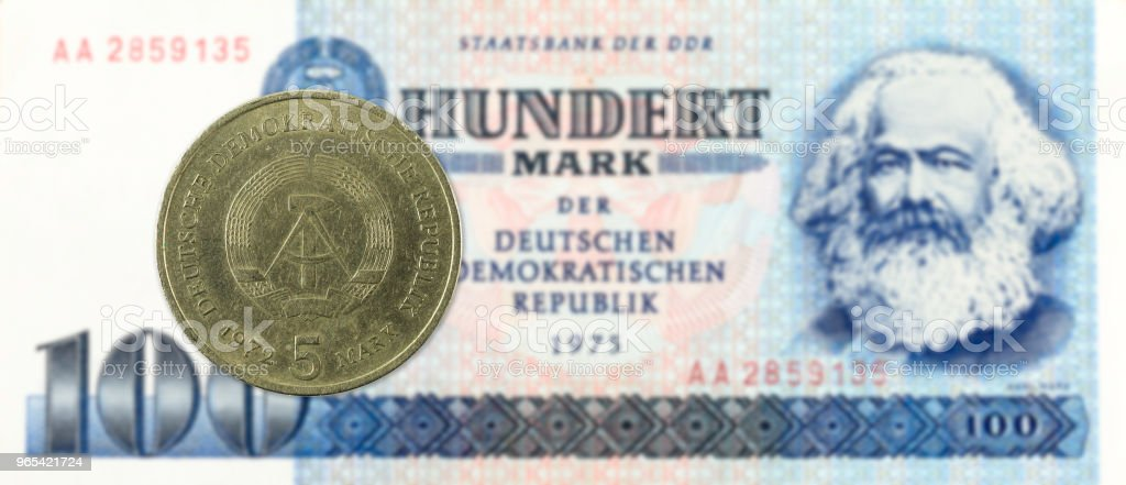 5 mark coin against historic 100 east german mark bank note zbiór zdjęć royalty-free