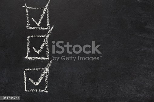 istock Marked checkboxses drawn with chalk on black background 931744744