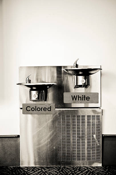 Marked drinking fountains depicting separation and racism a racist fountain / black and white segregation / a racist concept civil rights stock pictures, royalty-free photos & images