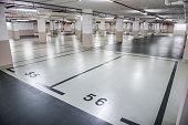 istock Marked parking spot in underground garage 1295515444