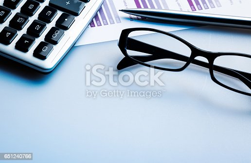 istock Marked stock price with glasses, calculator and pen. 651240766