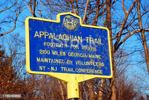 Bear Mountain, NY, USA March 6, 2006 A blue sign near Bear Mountain, New York, tells hikers they are on the oldest part of the Appalachian Trail