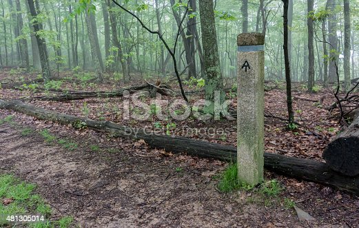A post provides information for Appalachian Trail hikers near a road crossing
