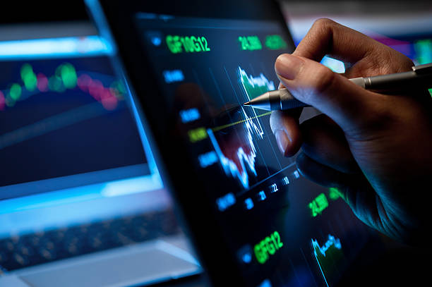 Market Analyze Market Analyze with Digital Moniter focus on tip of finger. stock market stock pictures, royalty-free photos & images