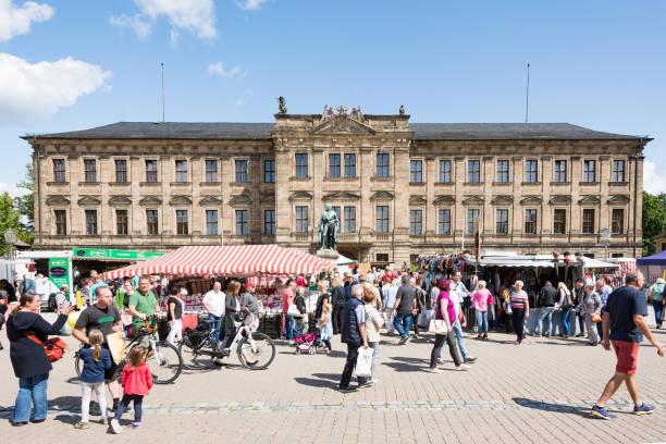 Market at Schloss Erlangen Erlangen: People at a market in front of Schloss Erlangen, Germany on August 20, 2017.  The castle was built in the year 1700. erlangen stock pictures, royalty-free photos & images