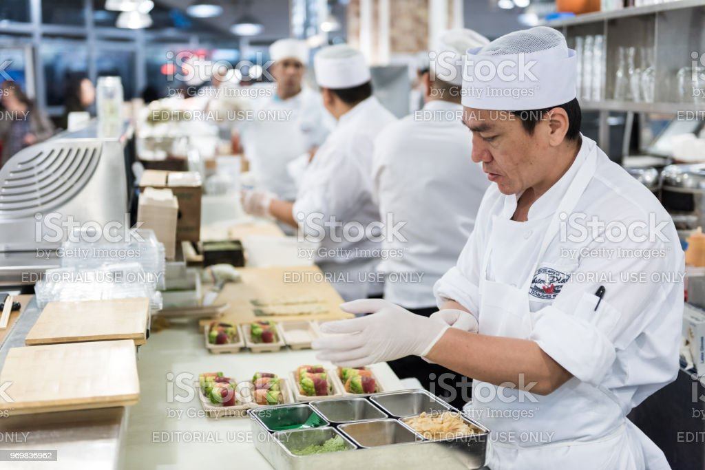Market food Lobster place shop interior inside in downtown lower Chelsea neighborhood district Manhattan NYC, Sushi Chef preparing food stock photo