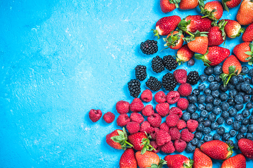 istock Market fresh mixed berry fruits, top view, border background 903081984