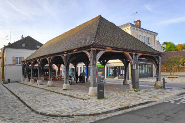 Market hall of Luzarches Luzarches, France - October 26 2019: The market hall (French: La Halle) in the city center. val d'oise stock pictures, royalty-free photos & images