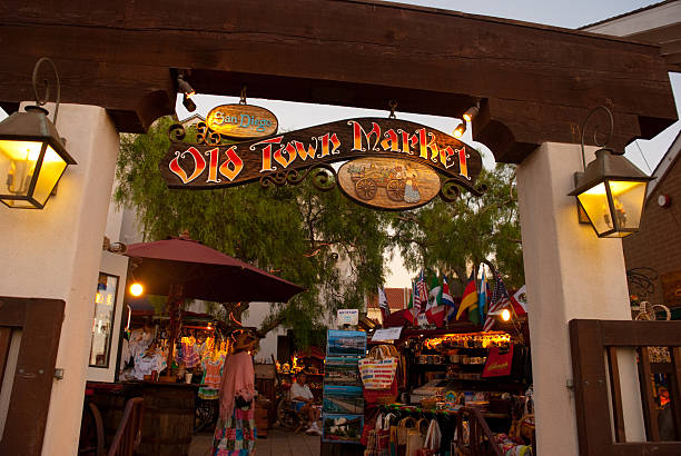 Market in Old Town San Diego San Diego, United States - August 21, 2007: The entrance of Old Town Market in the Old Town San Diego area.  Old Town San Diego is the oldest and most well preserved neighborhood of San Diego, as well as the first european settled place in California.  The centerpiece is the Old Town San Diego State Historic Park, which is closed off to auto traffic and has many old historic buildings and looks like how San Diego was more than 150 years ago. old town stock pictures, royalty-free photos & images