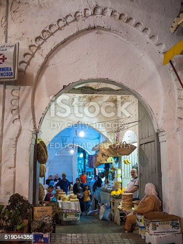 Tangiers, Morocco - July 8, 2010: People selling baskets, bread, and other food items in a small market in Tangiers, Morocco.