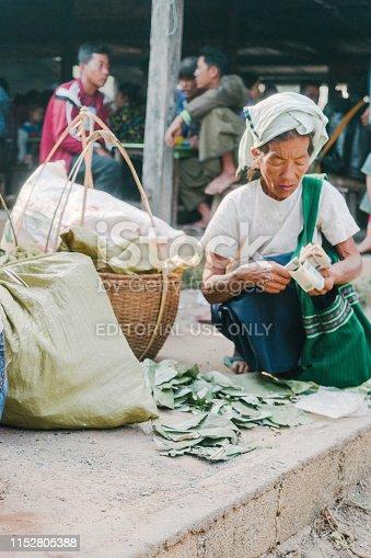 Inle lake, Myanmar, 24 March 2019: Woman selling good on market on Inle lake