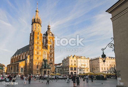 istock market place with saint mary´s church in Krakow, Poland 1299079284