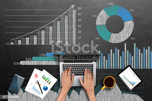 istock Market research business reports on laptop 527033580