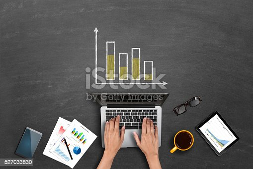 istock Market research business reports on laptop 527033830
