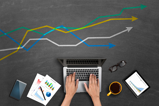 istock Market research business reports on laptop 540965992