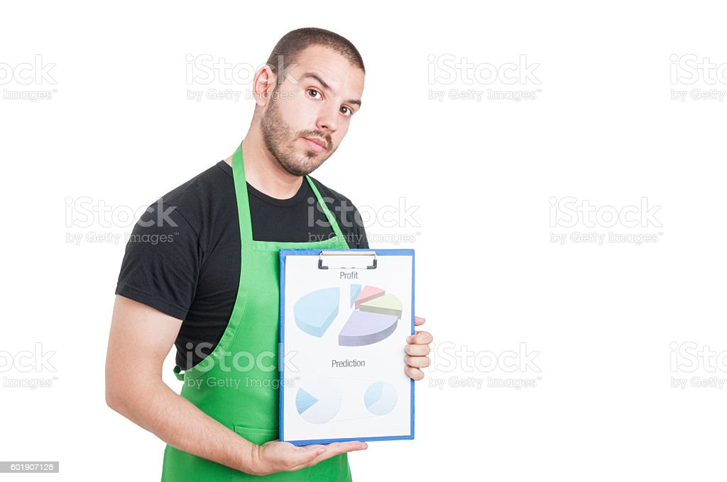 Market seller holding clipboard with profit and prediction stock photo