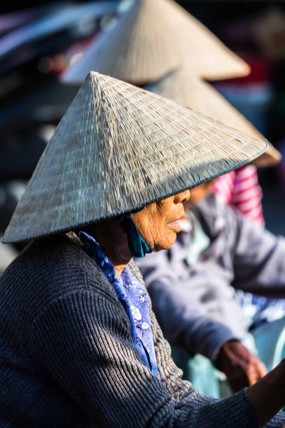 market sellers with non la hat - stephen lynn stock pictures, royalty-free photos & images