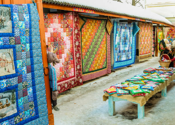 market series with bright colorful patchwork quilts in winter sunny day - quilt stock photos and pictures