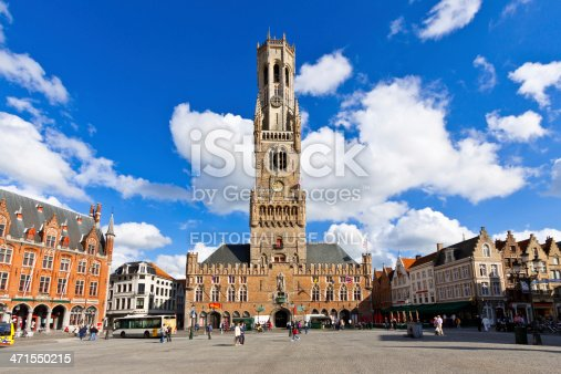 Bruges, Belgium - June 22, 2012: The Belfry (Belltower) in the Market Square (Markt).  It is a medieval bell tower in historic city center. Bruges has most of its medieval architecture well preserved and has been designated a UNESCO World Heritage Site. Tourists are walking around.